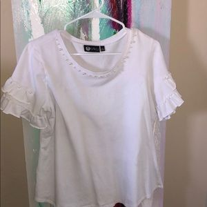 White shirt with pearl accents